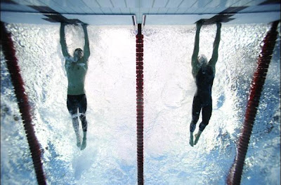 photo finish: Michael Phelps beats Milorad Cavic by 1/100 sec.