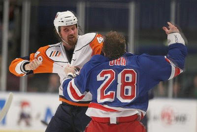 Mitch Fritz #49 of the Islanders and Colton Orr #28 of the New York Rangers fight on Dec. 29, 2008 at MSG in New York City.
