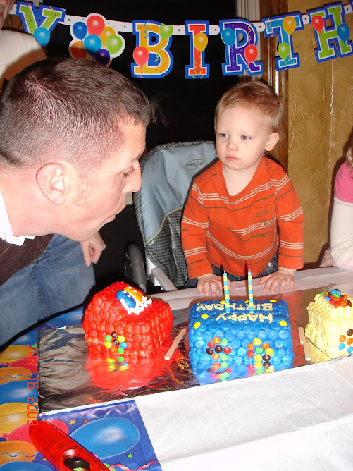 Uncle Matt blowing out Ryan's candles