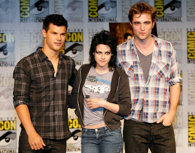 Taylor Lautner, left, Kristen Stewart, center, and Robert Pattinson
