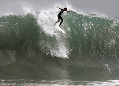 Surfers take to the 15-foot waves at the Wedge in Newport Beach