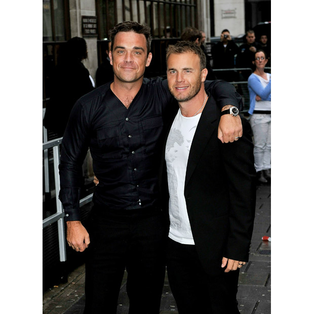 Robbie Williams and Gary Barlow arrive at the Radio 1 studios after releasing their new single Shame