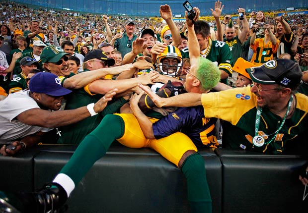 Donald Driver jumps into the crowd after catching a six-yard touchdown pass