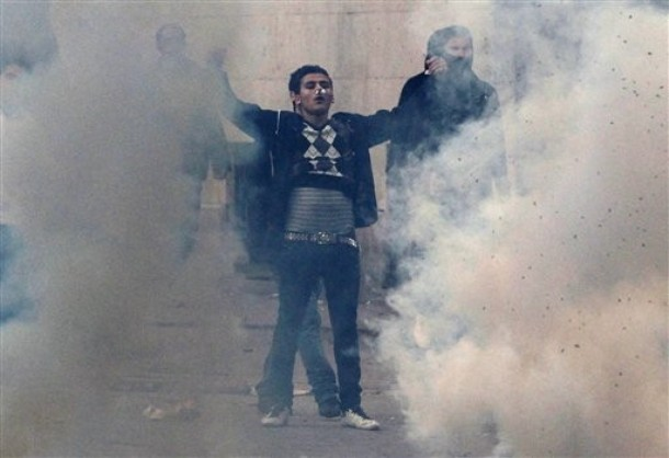 A demonstrators faces police during clashes in Tunis