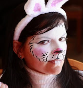 Me getting ready for work face painting myself as an Easter Bunny