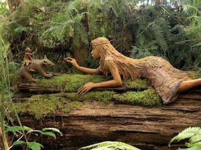 http://1.bp.blogspot.com/_osrVjnPbdEM/TA_-czMIeHI/AAAAAAAAdGQ/B1SrFupAqcI/s400/Garden_wooden_sculptures_1.jpg