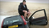 Sam Hamilton sitting on his sinking car