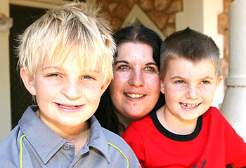 Lachlan Nally with his mother Kim March and his brother Alex, 8.