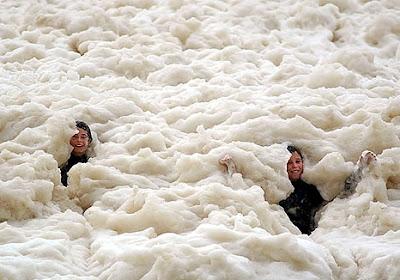 Beach swallowed with foam