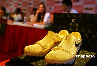 Gold racing shoes