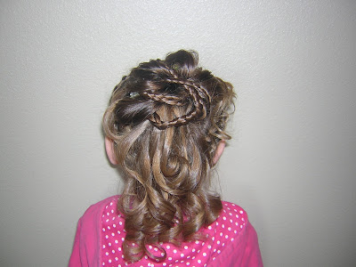 I was thinking this would be a cute hairstyle for a flower girl too.
