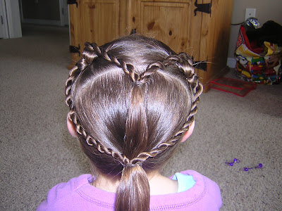 Now bring the outer 2 twist braids down and gather everything in with the