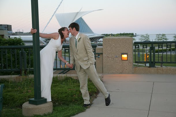 John and Ellie kissing at sunset during their wedding by the Calatrava Art Museum