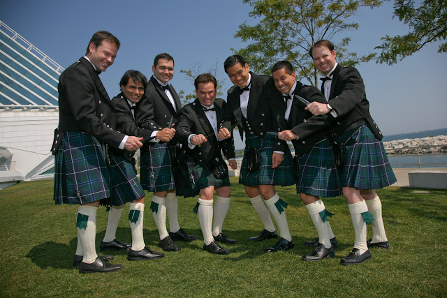 Groom and groomsmen in Scottish attire by Calatrava