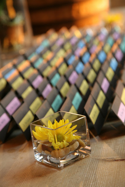 Flower and placecards at Hinterland Erie Street Gastropub wedding reception