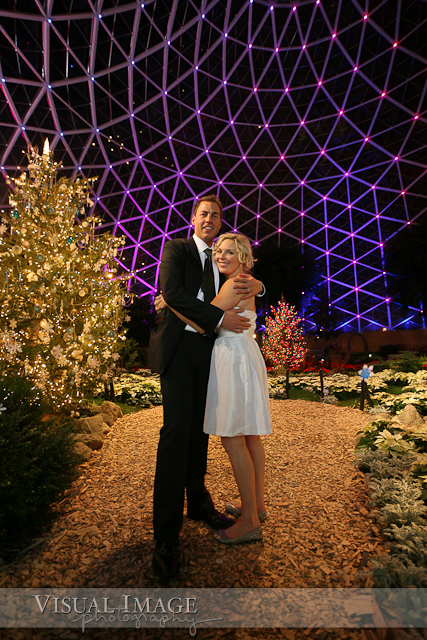 Portrait of bride and groom in Milwaukee Domes with purple lights