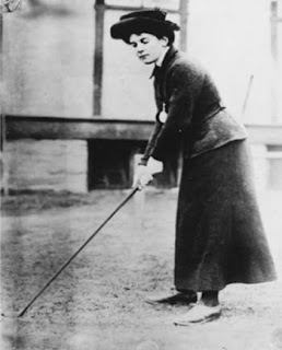 Old Victorian lady playing golf with retro clubs