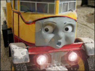 Thomas and Isabella the lorry with her head lights on