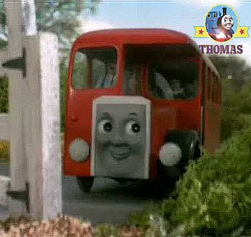 Standing at the level crossing was Bertie the red bus