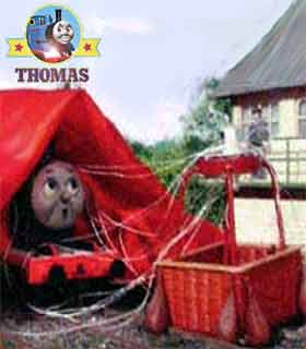 The flying airship comes into land straight on top of train James and the red balloon did cover him