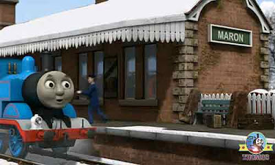 Thomas the blue train traveling to Knapford another large cap on the Maron station platform bench