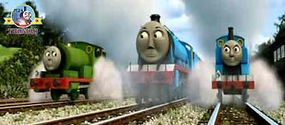 Thomas the tank engine Gordon the blue train with Percy the small engine laughed at pink James tank