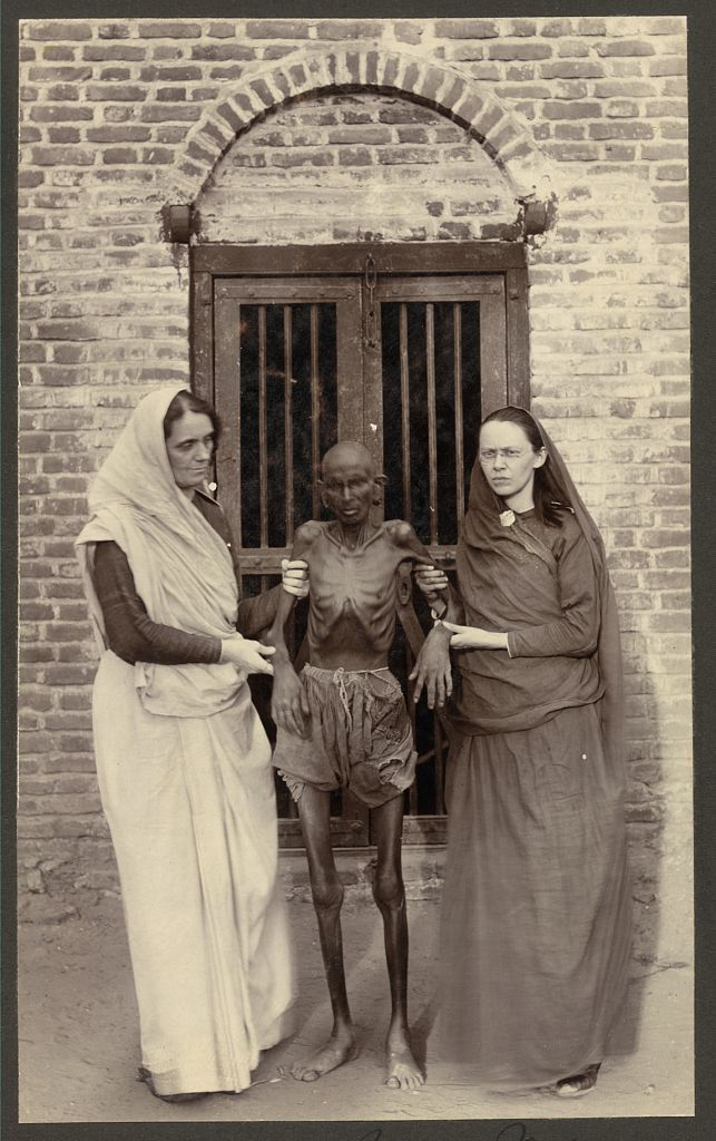 Miss Neil and a famine victim, India - Early 20th Century