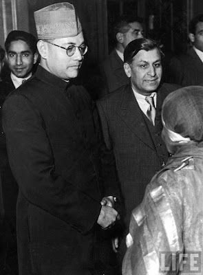 Subhas Chandra Bose (L) greeting admirers in 1940