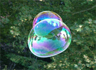 Thin film interference demonstrated with soap bubbles.