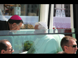 Pope Benedict XVI speaking to the Latin Patriarch of Jerusalem Fouad Twal inside the Pope mobile car image