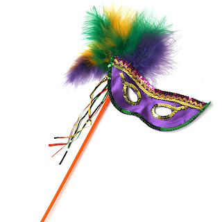 Mardi Gras Mask to around the eyes with a handle photo