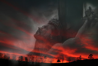 Jesus Christ on the Cross in the sky looking on the sunset background photo