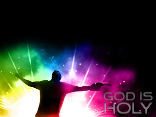 God is holy with praying hands and colorful rainbow background in night effect image