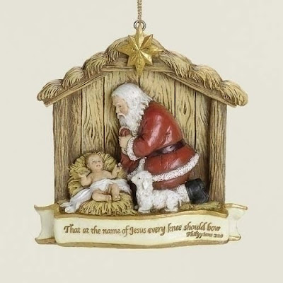 kneeling santa ornament in stable with verse