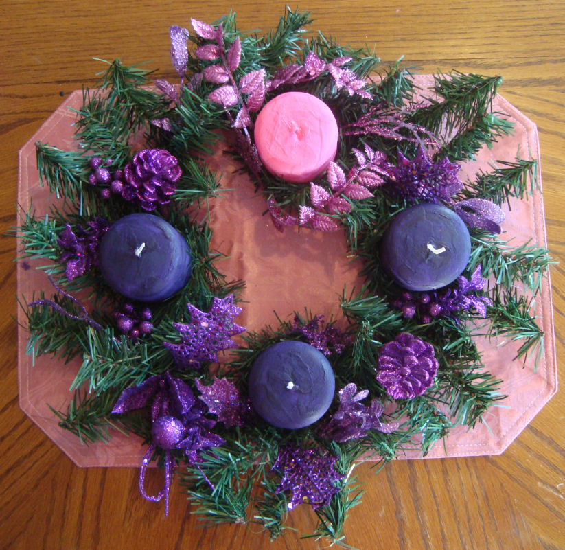 Here's my wreath with my newly painted pink and purple candles!