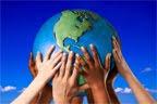 children's hands holding globe