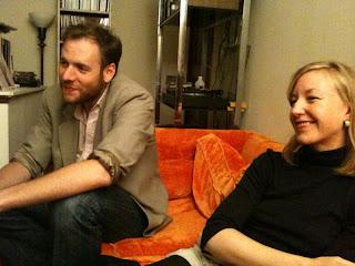 John & Elisa, orange couch
