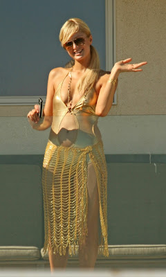 Paris Hilton Pictures GOLDEN BIKINI OUTFIT from  Malibu Beach House