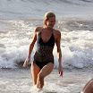 Paris Hilton bathing in black bikini beach - Papparazi pics