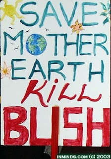 "Save Mother Earth, Kill Bush"" says this sign from a November 20, 2003 protest"