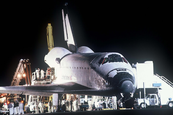 Space Shuttle Columbia, makes a night landing at Edwards AFB, California