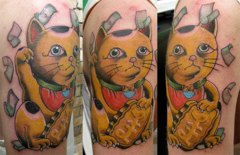 for his blinged out maneki neko tattoo. now what you have to understand