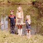 Our kids by the pond