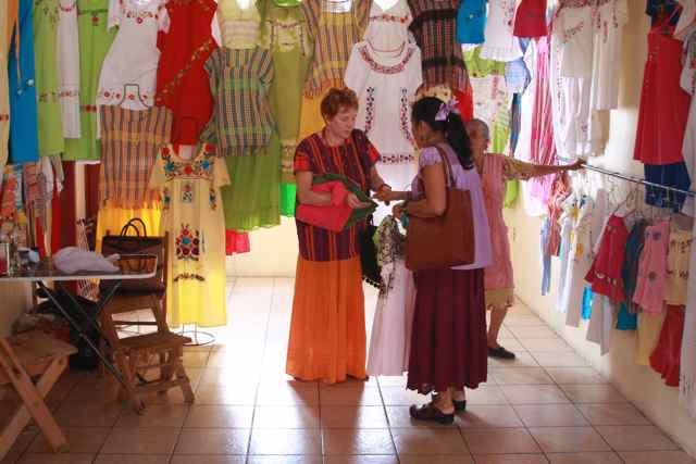 Kim and Nora in textile shop, Ocotlan, 2009