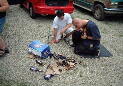 funny-picture-people-crying-over-broken-beer-bottles