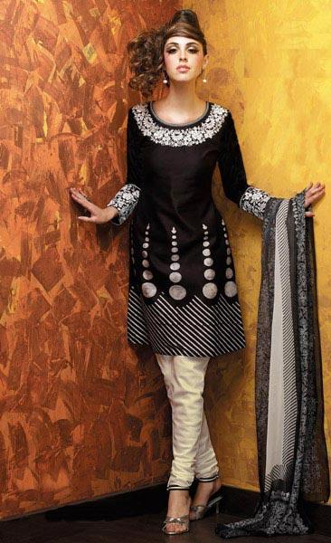 This is graceful black and cream churidar pajama suit with embroidery and
