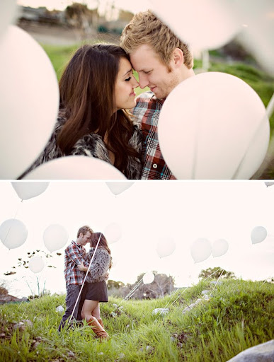 engagement photos with lots of white balloons