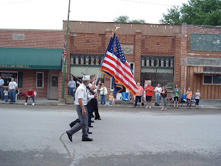 Veterans with Flag leading the parade