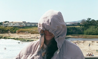 Me in Santa Cruz on a very windy day. Photograher wishes to remain anonymous.