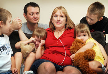 LONG wait ... Amy Evans, pictured with Jeremy, James, Danielle, Jennifer and Thomas is battling a rare condition and waiting for a lung transplant.